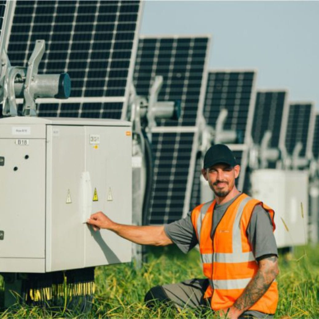 grid overview solar farm worker
